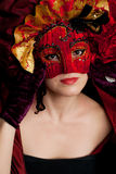 Woman wearing a  red carnival mask. Woman wearing  a  red venetian  carnival mask Royalty Free Stock Photography