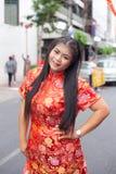 Woman wearing red cheongsams. Stock Image