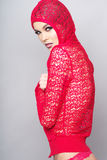 Woman wearing red clothes on grey background Royalty Free Stock Image