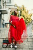 Woman Wearing Red Crew-neck Dress Walking on the Stairs Photography royalty free stock image