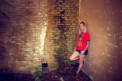 Woman Wearing Red Crew-neck Sleeved Shirt and Blue Denim Short Shorts royalty free stock photos