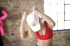 Woman Wearing Red Crop Top and White Cap Stock Photos