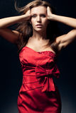 Woman wearing red dress Stock Photography