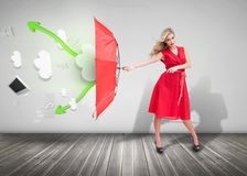 Woman wearing red dress and holding umbrella royalty free stock photography