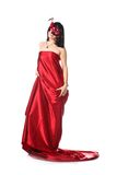Woman wearing red dress and a mask Stock Images
