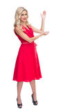 Woman wearing red dress presenting something Stock Photography
