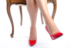 Woman wearing red high heel shoes Stock Images