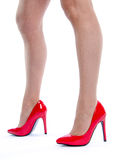Woman wearing red high heel shoes Stock Photography