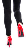 Woman wearing red high heel shoes Royalty Free Stock Photos