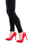 Woman wearing red high heel shoes royalty free stock photography