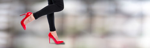 Woman wearing red high heels. Woman wearing red high heel shoes Stock Images