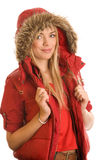 Woman wearing red hooded parka. Portrait of young pretty woman wearing red hooded parka isolated on white background Royalty Free Stock Photos