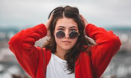 Woman Wearing Red Jacket and Sunglasses stock images