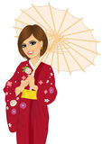 Woman wearing red kimono and holding a japanese parasol Stock Image