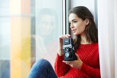 Woman Wearing Red Knitted Shirt Holding Instant Camera Royalty Free Stock Images