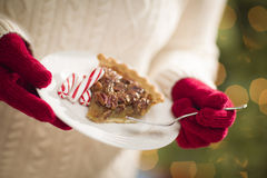Woman Wearing Red Mittens Holding Plate of Pecan Pie, Peppermint Royalty Free Stock Photos