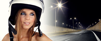 Woman wearing a red motorcycle helmet Royalty Free Stock Photo