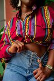 Woman Wearing Red and Multicolored Crop Top stock images