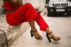 Woman Wearing Red Pants and Black Leather Ankle Strap Sandals Royalty Free Stock Photography