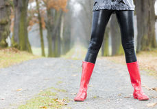 Woman wearing red rubber boots Royalty Free Stock Photos