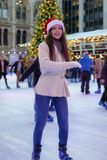 Woman has fun ice skating on a Christmas market stock images