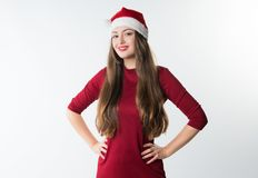 Woman wearing red santa claus hat Stock Photography