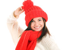 Woman wearing red scarf and cap. Funny young woman wearing red scarf and cap isolated on white background Royalty Free Stock Photo