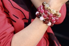 Woman wearing a red shirt and bracelet jewelry. Stock Photography