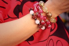 Woman wearing a red shirt and bracelet jewelry. Stock Image