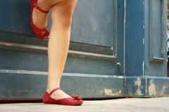 Woman wearing red shoes at the park Royalty Free Stock Photography