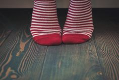 Woman wearing red socks on the floor. Template for design. Woman wearing red socks standing on the floor. Template for design royalty free stock photo