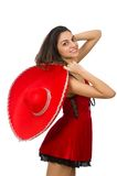 Woman wearing red sombrero Stock Images
