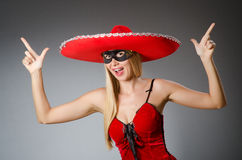 Woman wearing red sombrero Stock Image