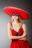 Woman wearing red sombrero Royalty Free Stock Photo