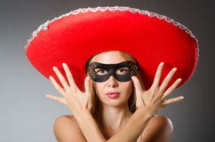 Woman wearing red sombrero Royalty Free Stock Photography
