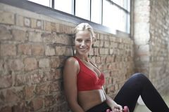 Woman Wearing Red Sports Bra and Black Pants Stock Images