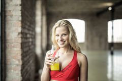 Woman Wearing Red Sports Bra Holding Clear Plastic Bottle Royalty Free Stock Photos