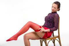 Woman wearing red stockings Stock Images