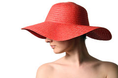 Woman wearing red straw hat stock image