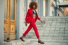 Woman Wearing Red Suit and Pants Outfit Royalty Free Stock Images