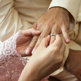 Woman wearing ring to man  in wedding ceremony Royalty Free Stock Images
