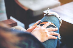 Woman wearing ripped jean Stock Image