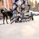 Woman Wearing Rollerblades Skating While Pushing Baby Stroller Royalty Free Stock Photo