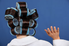 Woman wearing rollers Stock Images
