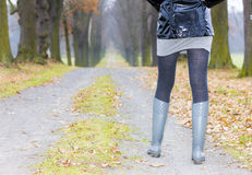 Woman wearing rubber boots Royalty Free Stock Photos