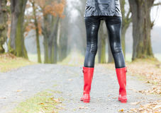 Woman wearing rubber boots Royalty Free Stock Image