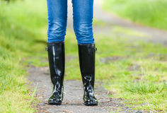 Woman wearing rubber boots Stock Images