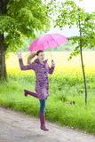 Woman wearing rubber boots Stock Photo