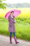 Woman wearing rubber boots with umbrella Stock Image