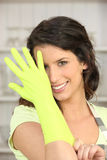 Woman wearing rubber gloves Stock Photo